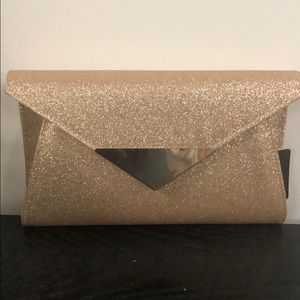 New with Tags shimmer clutch , rose gold